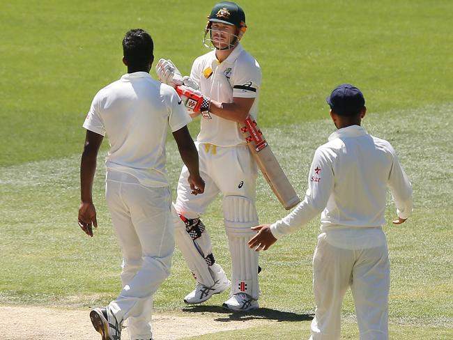 Indian bowler Varun Aaron and David Warner go head to head.