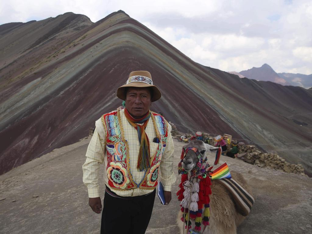 Community leader Gabino Human has seen a massive influx of tourists. Picture: AP/Martin Mejia