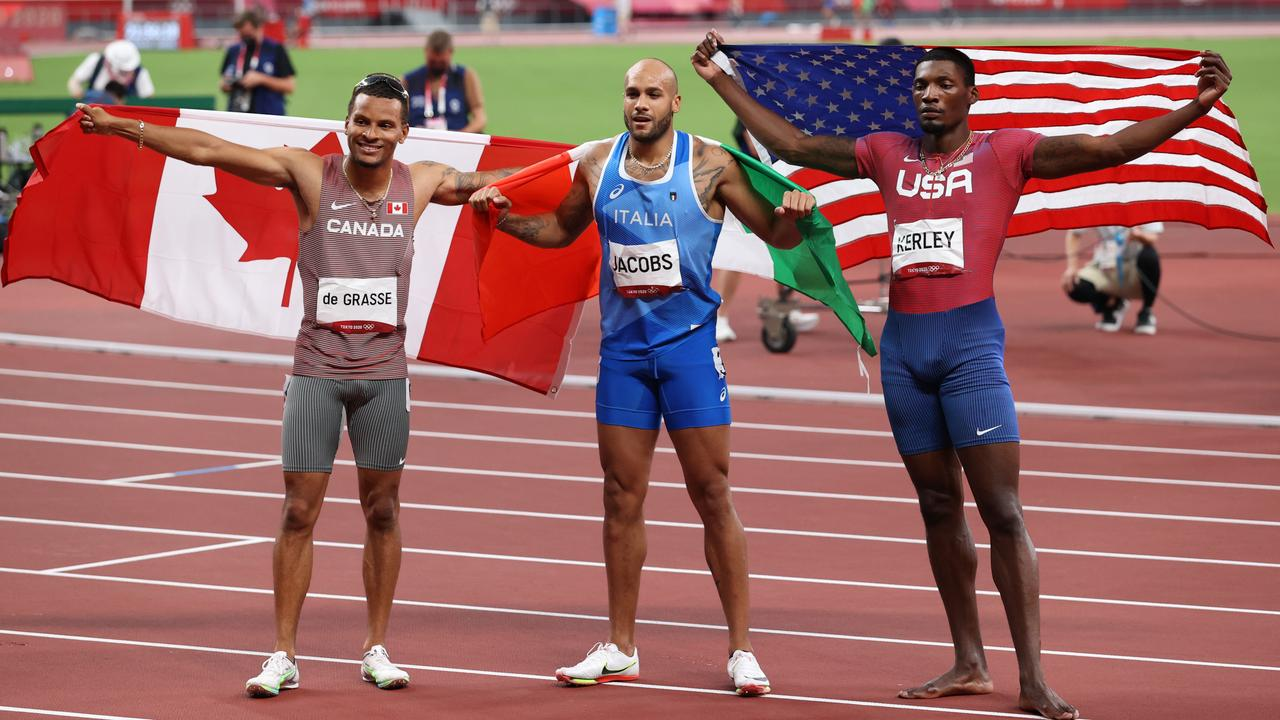 Andre de Grasse, Lamont Marcell Jacobs and Fred Kerley pose after the race. (Photo by Ian MacNicol/Getty Images)
