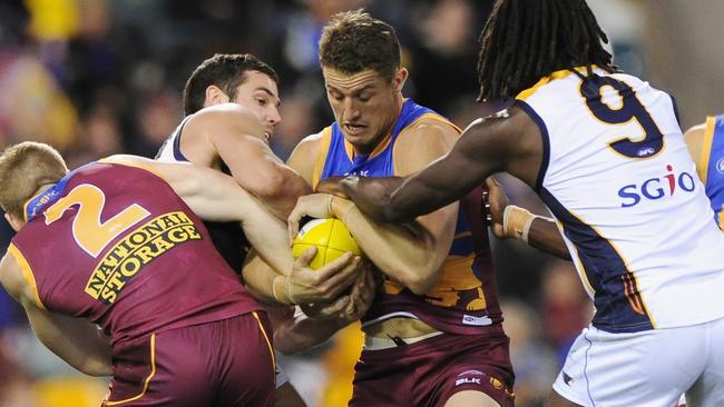 Matt Maguire tries to bust through an Eagles gang tackle.