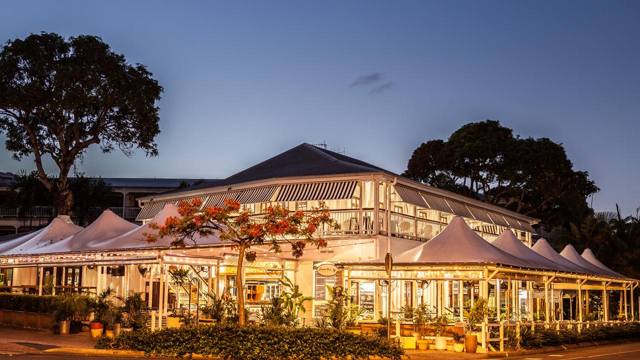 Waiting times for food have been long during peak times at many Port Douglas eateries, including the famous Court House Hotel (pictured), due to the rush of tourists combined with staff shortages and coronavirus restrictions.
