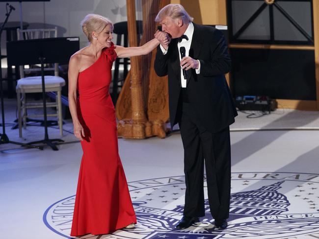 Donald Trump kisses the hand of Kellyanne Conway during a VIP reception and dinner with donors. Picture: AP Photo/Evan Vucci