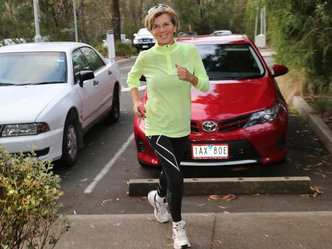 Looking happy ... Julie Bishop running to Parliament House. Picture: Craig Greenhill