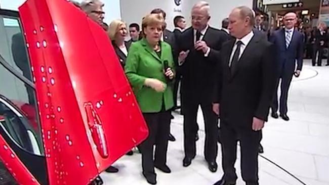 Topless protestors bare all for Putin