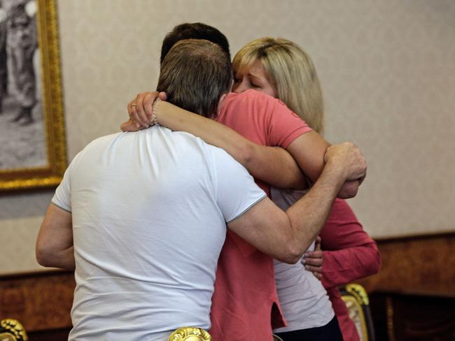 Shattered ... Relatives of murdered British tourist Hannah Witheridge hug ahead of a police briefing at the Thai police headquarters in Bangkok. Picture: AFP