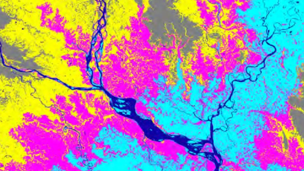 Dark blue areas show water bodies in Dhaka, Bangladesh, with the light blue areas indicating sea level rise by 2100 under a 4C warming scenario. The pink areas show the multi-century impact in a 2C scenario, with the yellow showing the 4C scenario. Source: Climate Central