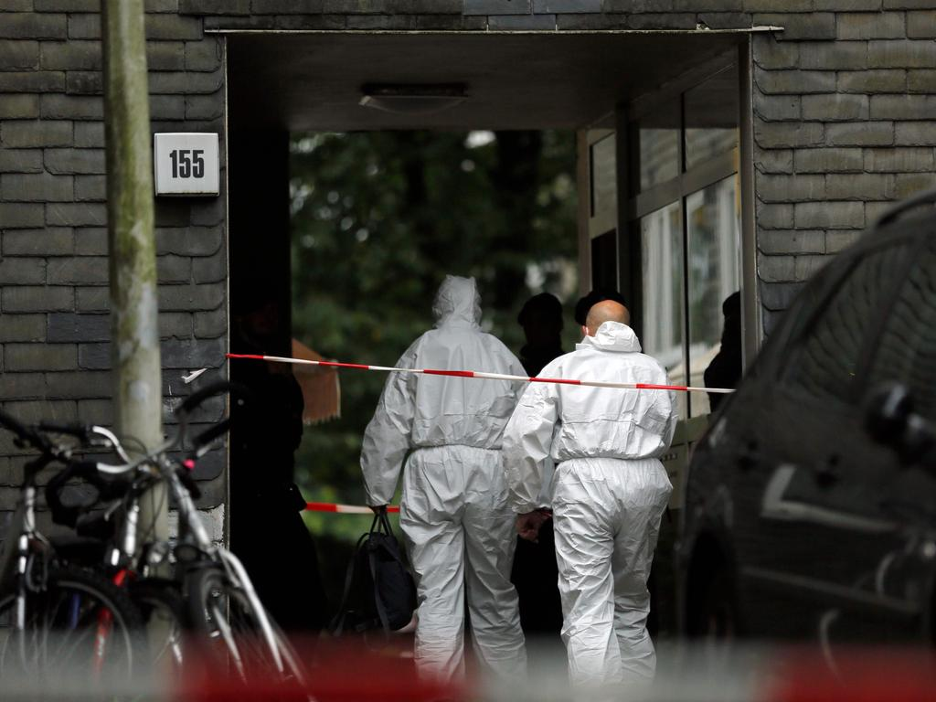 Forensic experts enter in a building where five children were found dead in an apartment on September 3, 2020 in the city of Solingen, Germany. Picture: AFP