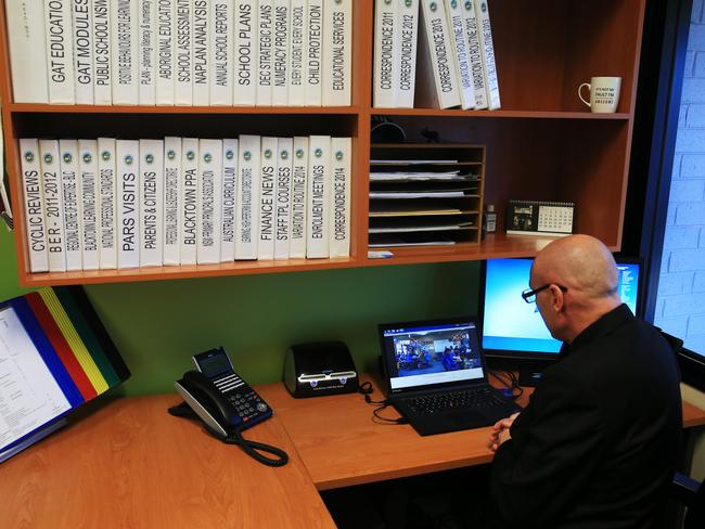 Quakers Hill Public School principal Bert Lo Campo Skype calls one of the classrooms from his office. Picture: Toby Zerna