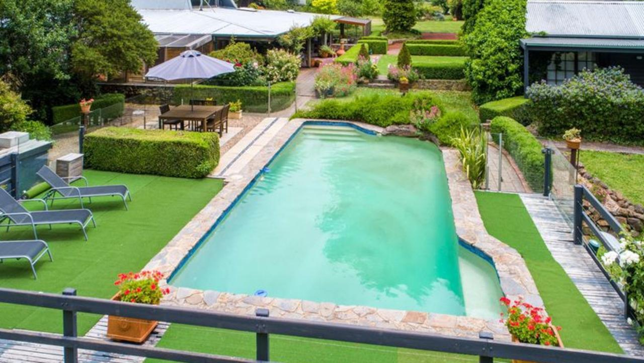 The property features a pool with space for lounging …