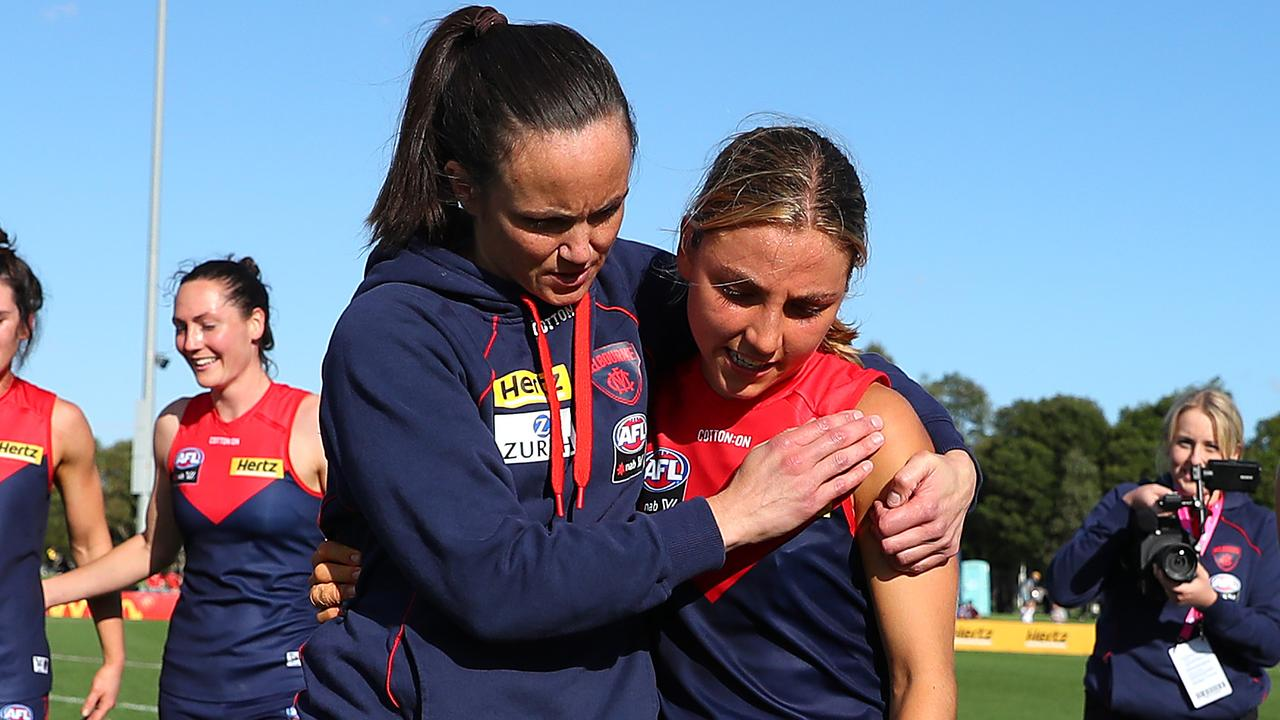 MELBOURNE, AUSTRALIA - MARCH 27: Daisy Pearce (c) of the Demons is seen in a leg brace, with Eliza McNamara of the Demons after the round 9 AFLW match between the Melbourne Demons and the Brisbane Lions at Casey Fields on March 27, 2021 in Melbourne, Australia. (Photo by Kelly Defina/Getty Images)