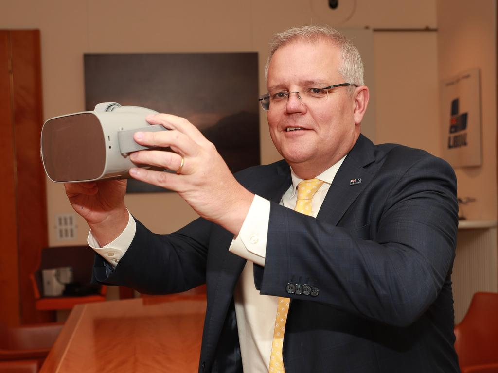 A powerful storytelling device … PM Scott Morrison tests Anzac360 on an Oculus headset in November 2019. Picture Gary Ramage