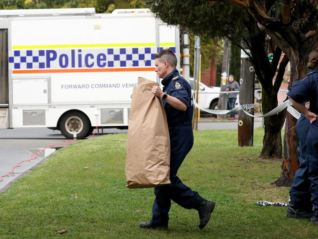 Forensic police remove evidence from the Bedford home. Picture: AAP