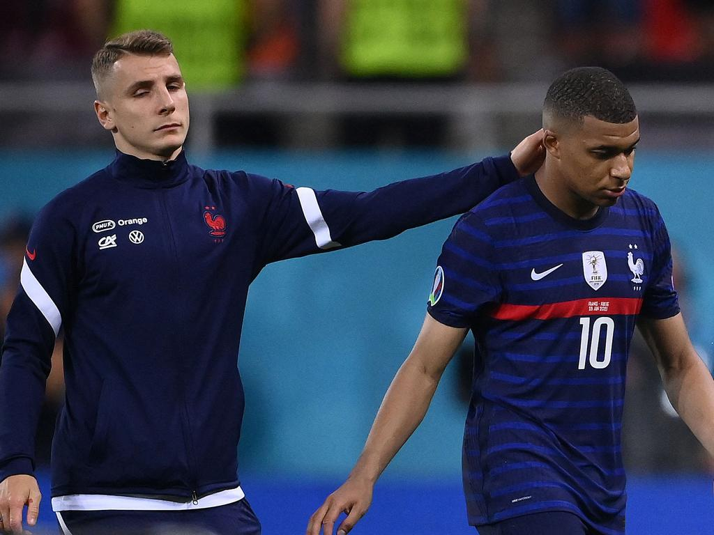 Kylian Mbappe (right) was devastated (Photo by FRANCK FIFE / POOL / AFP).
