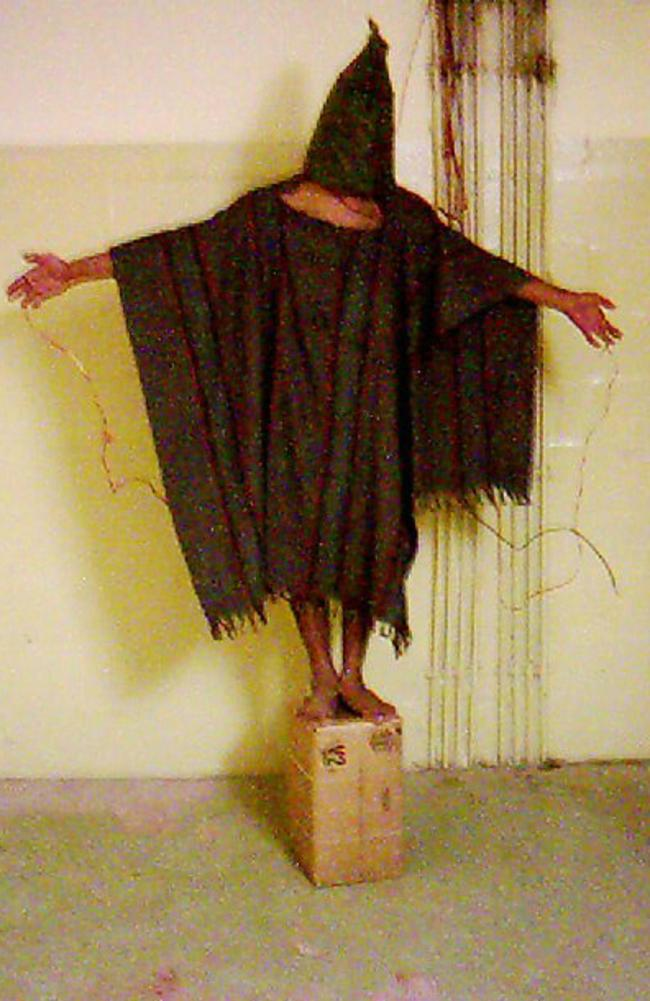 Abu Ghraib: This is an image obtained by The Associated Press shows an unidentified detainee standing on a box with a bag on his head and wires attached to him in late 2003 at the Abu Ghraib prison in Baghdad, Iraq.