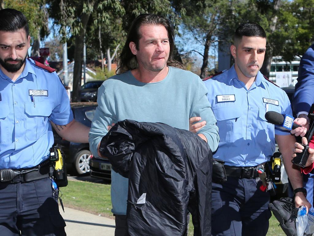 Ben Cousins arrives at a courthouse.
