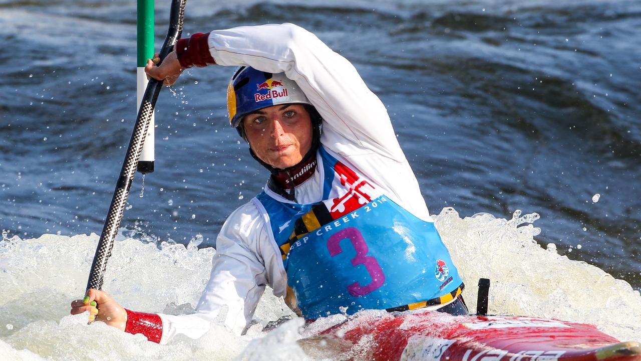 Australian canoeist Jessica Fox celebrates her victory in the K1 event after creating history by winning gold in the K1W and C1W events at the ICF Canoe Slalom World Championships in Deep Creek, USA overnight. The historic double comes 25 years since her mother Myriam and father Richard won K1 gold in the USA.