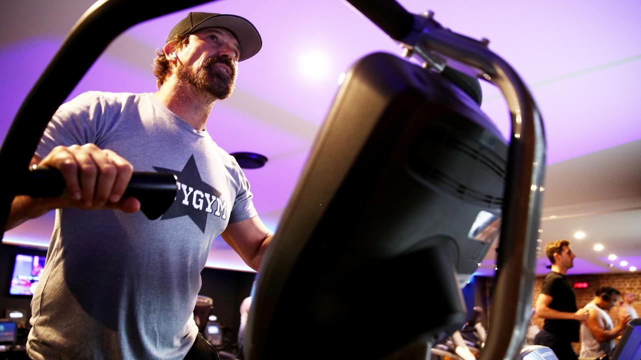 Personal Trainer Campbell Bannerman is seen running on a treadmill at a class at City Gym in East Sydney on Monday as Covid restrictions ease across NSW. Picture: Don Arnold/Getty Images