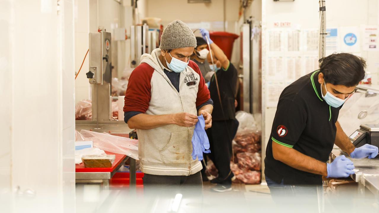Workers at a butcher shop in Lakemba. Picture: Jenny Evans/Getty Images