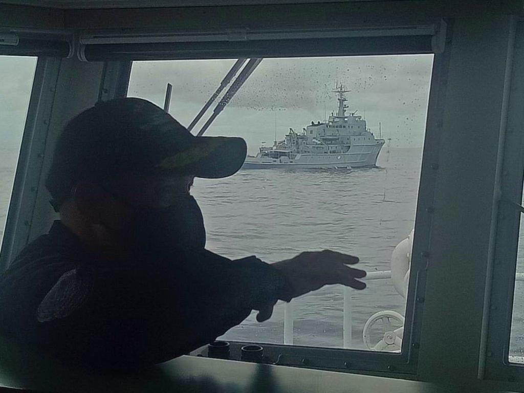 A picture taken from the command deck of the Philippines Coast Guard vessel BRB Cabra, showing the intruding Chinese naval survey vessel in the background. Picture: Philippines Coast Guard.