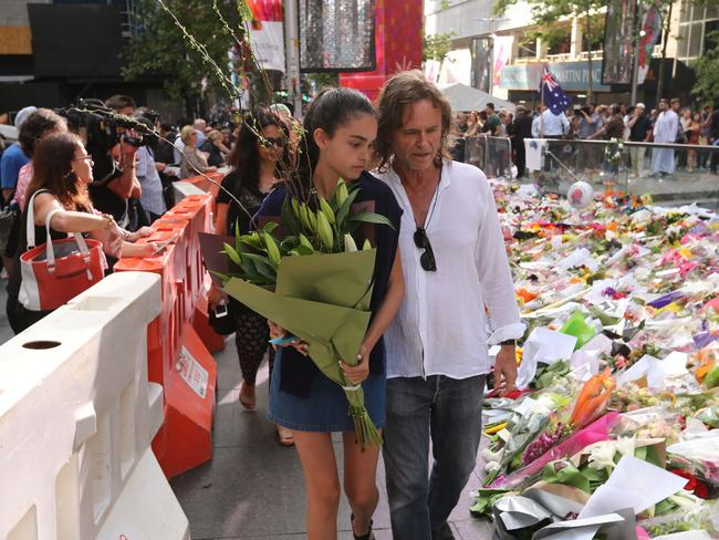 Tori's youngest sister Rada and Father of Tori Johnson, Ken visit the memorial.