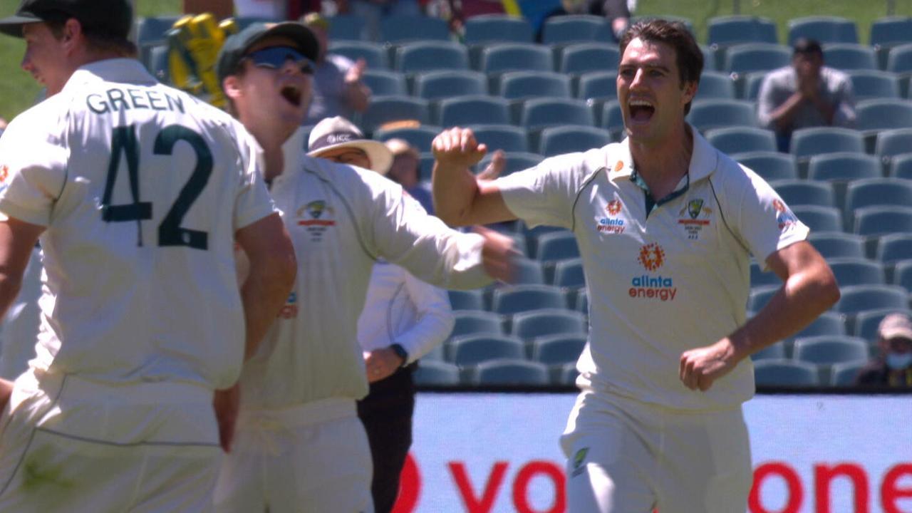 Pat Cummins celebrates the wicket of Virat Kohli.