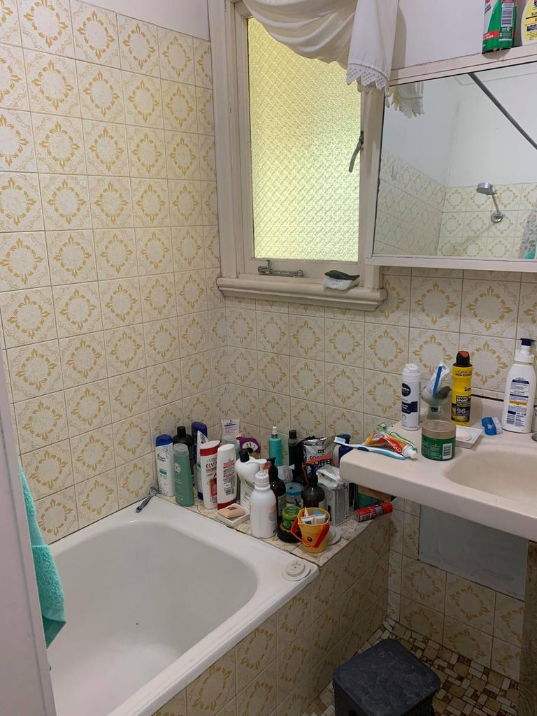 She placed the tiles over the existing ones. Picture: Supplied