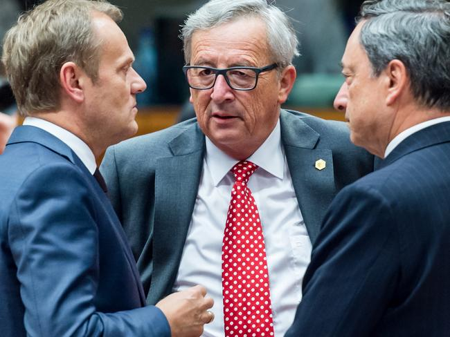 Emergency talks ... European Council President Donald Tusk (left) speaks with European Central Bank Governor Mario Draghi (right) and European Commission President Jean-Claude Juncker during a round table meeting at an EU summit in Brussels on June 25. Picture: AP Photo/Geert Vanden Wijngaert