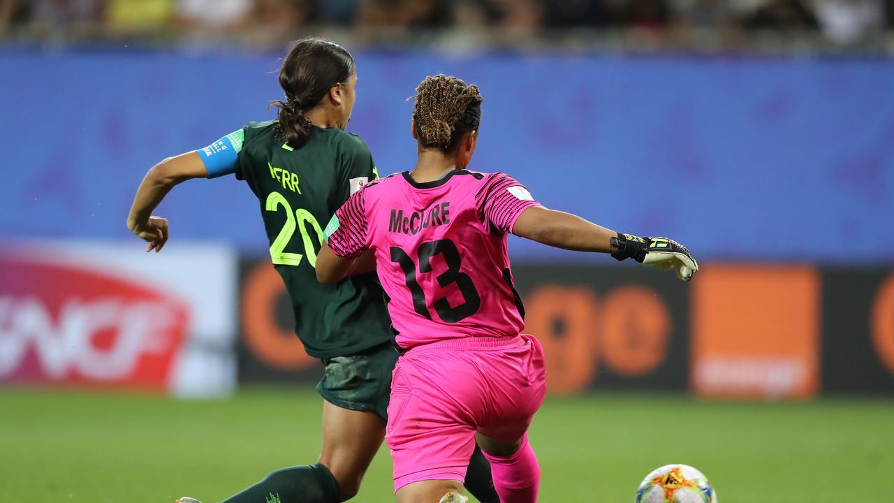 Sam Kerr of Australia scores her team's fourth goal