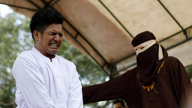 An Acehnese man is whipped in front of the public for violating sharia law in Banda Aceh, Indonesia, 27 February 2017. The man was caned for having unmarried sex. Picture: Hotli Simanjuntak.