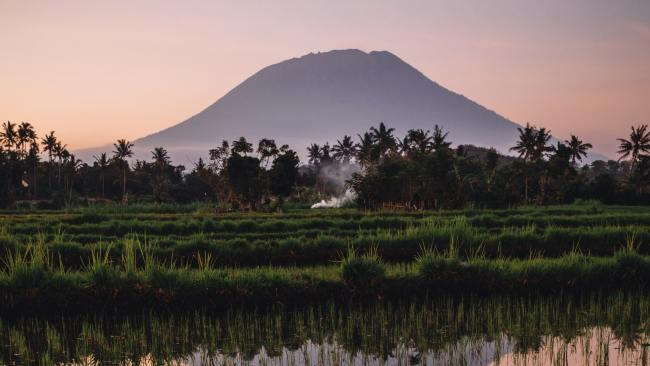 2/32Mount Agung Mount Agung is south of Batur, and currently the more smoking-sassy of the two. Erupting most recently from 2017 to 2019; ash, debris, lava and mudflows were reported.Picture: Maksym Ivaschenko / Unsplash