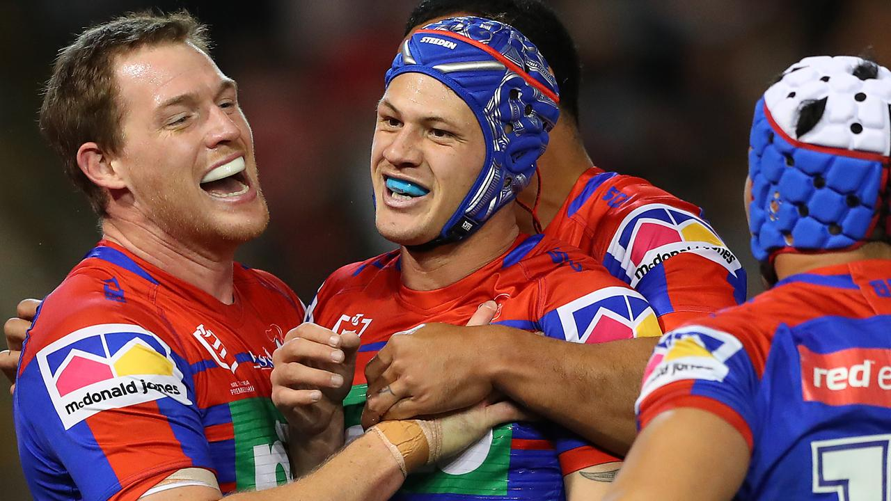 The Knights have tabled Kalyn Ponga (centre) a contract extension. (Photo by Tony Feder/Getty Images)