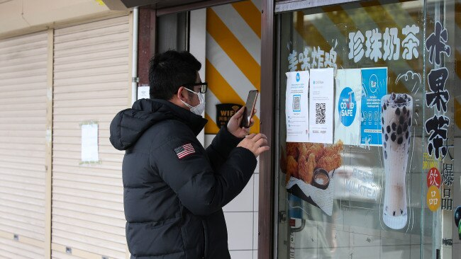 A shopper checks-in to a store in Auburn Town Centre during Sydney's lockdown. Picture: NCA NewsWire/ Gaye Gerard