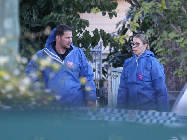 Officers prepare to search the Danny Road house this morning. Picture: John Grainger
