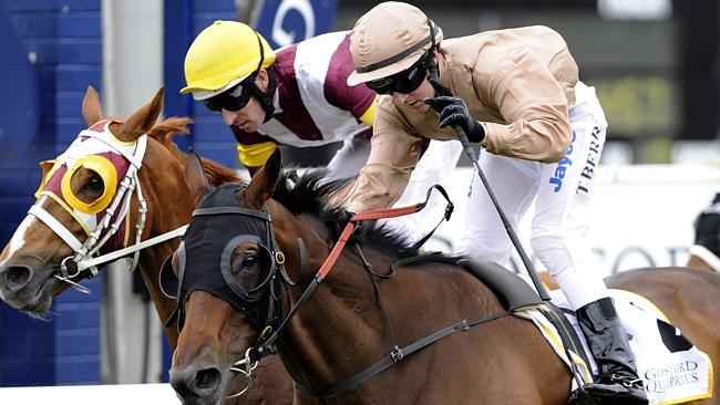 Tommy Berry (left) and Hugh Bowman go head to head in the 2010 Gosford Gold Cup.