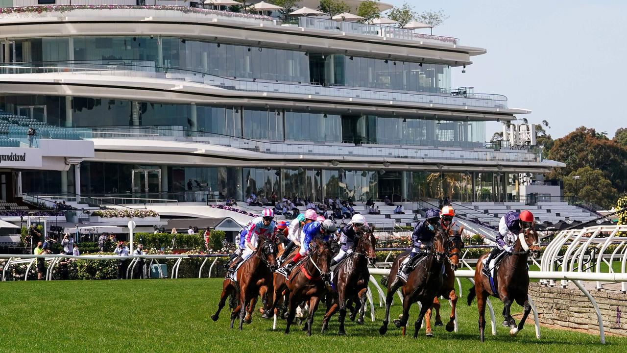 Melbourne Cup winner Twilight Payment leaves the home straight in front of empty grandstands.