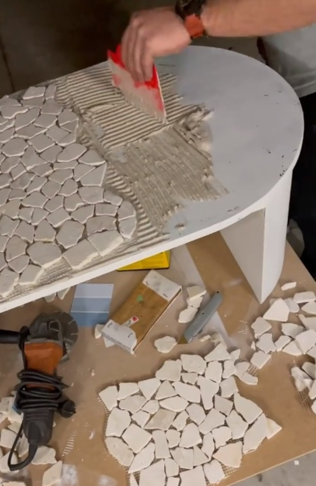 Maddison and her partner James painted the table white before gluing on mosaic tiles from Bunnings. Picture: TikTok/maddisoneblack