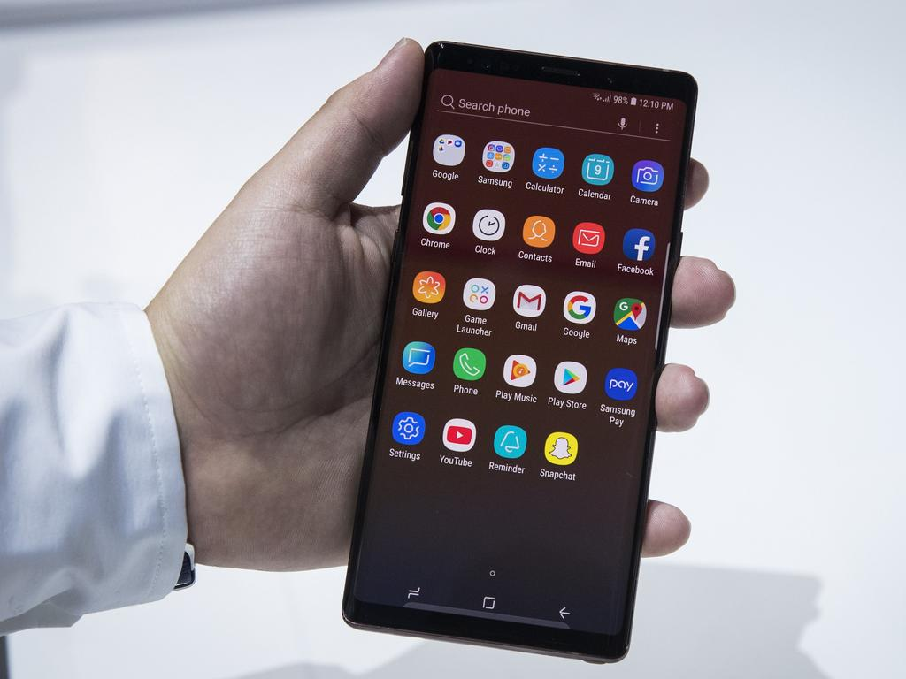 A Samsung employee displays the new Samsung Galaxy Note 9 smartphone. Picture: Drew Angerer/Getty/AFP