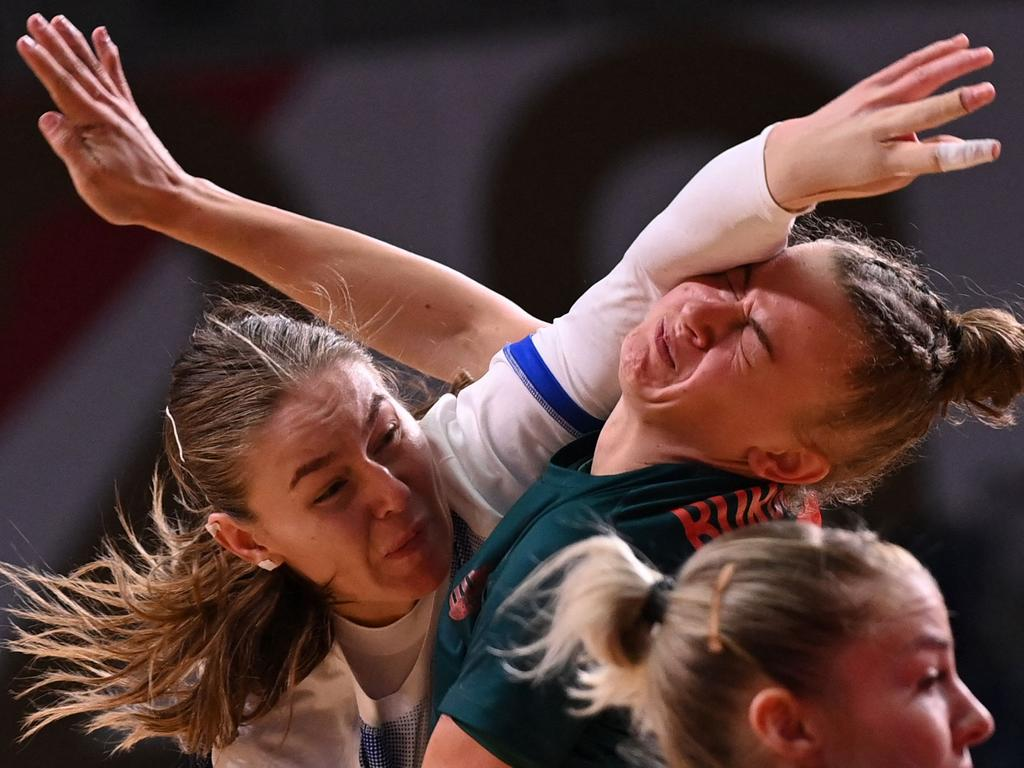Handball isn't for the faint hearted – Russia's right back Antonina Skorobogatchenko (L) shoots and hits the face of Hungary's pivot Reka Bordas during the women's preliminary round group B handball match. Picture: Martin Bernetti/AFP