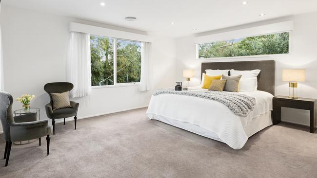 Two bedrooms with walk-in wardrobes and ensuites provide an option for an upstairs or downstairs main.