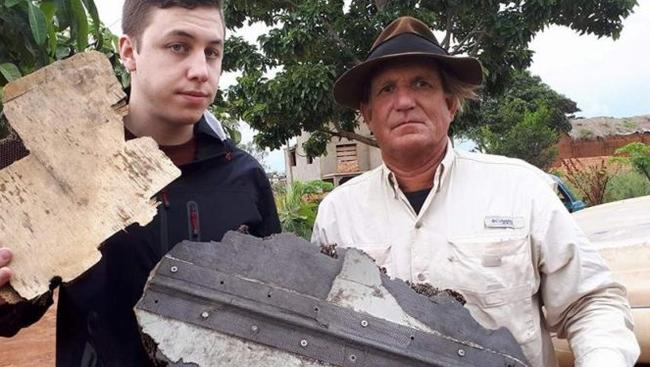 American Adventurer-detective Blaine Gibson (right) and Nick Connite in Madagascar with the two new possible MH370 pieces that Malaysian diplomat Zahid Raza was due to collect before his murder last week. Picture: Blaine Gibson