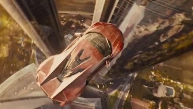 Incredible stunts ... the car jumping from one skyscraper to another in the new film.
