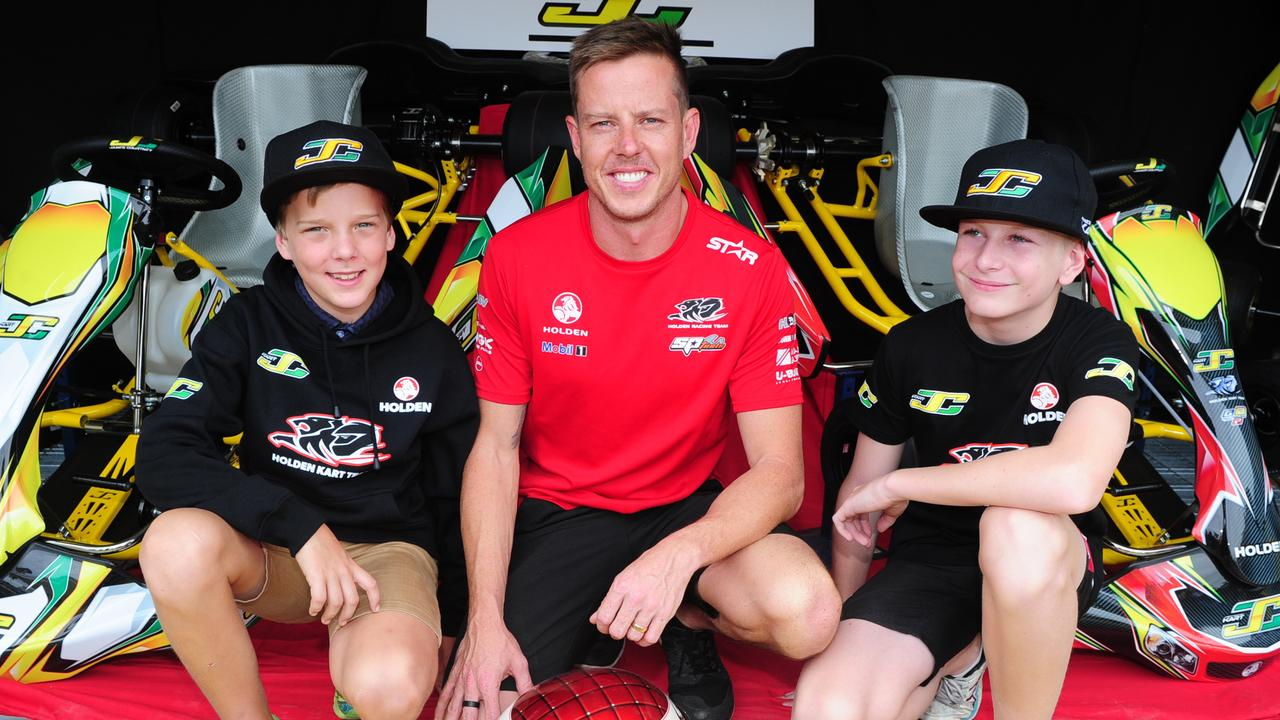 Townsville 400 Castrol Edge V8 Supercars Friday. Holden Racing Team's James Courtney with local kart kids, Tristan Lambert 12yo of Nth Shore and Thomas Turner 13yo of Douglas.