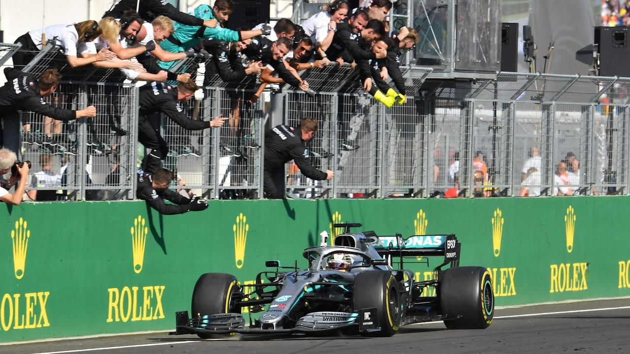 Hamilton celebrates with his teammates after winning the Hungarian Grand Prix.