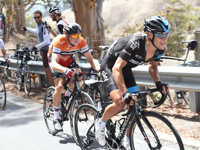Tasmania's Richie Porte (right) attacks Adelaide's Rohan Dennis. Picture: AFP