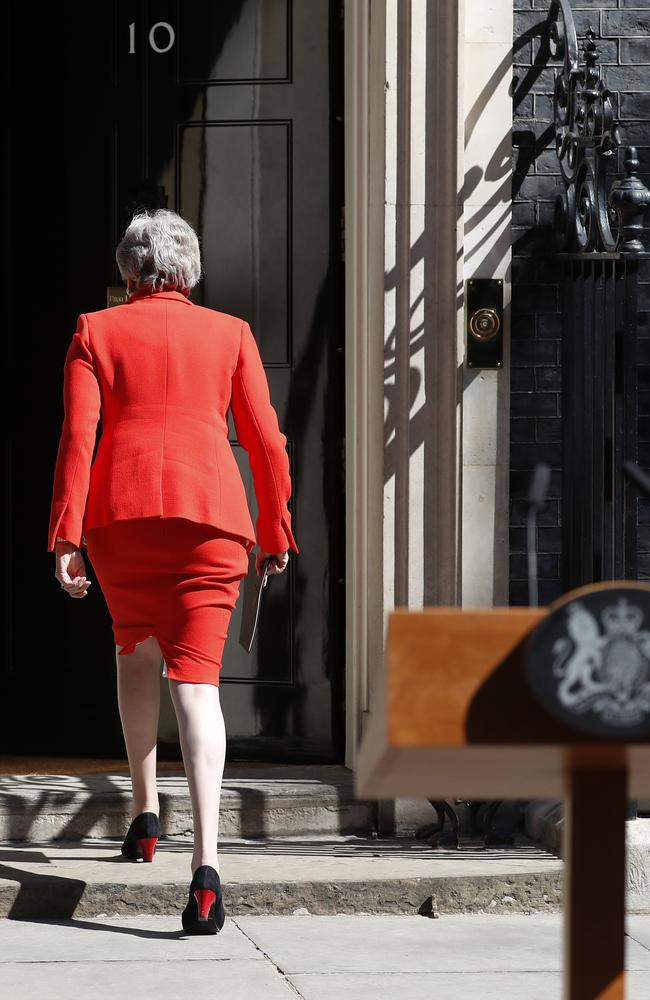 British Prime Minister Theresa May walks away after making her speech in the street outside 10 Downing Street in London. Picture: AP