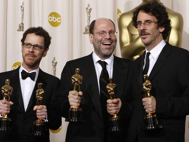 Top execs ... 'No Country for Old Men' producers (from left) Ethan Coen, Scott Rudin and Joel Coen collect the best picture Oscar in 2008. Picture: AP