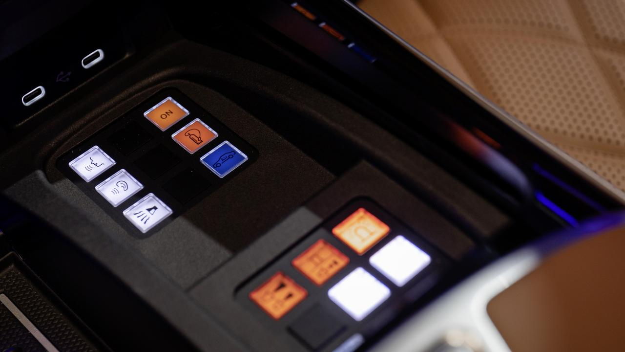 Drivers have access to James Bond-style gadgets on a special control panel.