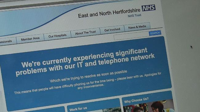 This photograph, posed as an illustration on May 12, 2017, shows the website of the NHS: East and North Hertfordshire notifying users of a problem in its network taken outside the Department of Health in London.  The unprecedented global ransomware cyberattack has hit more than 200,000 victims in more than 150 countries, Europol executive director Rob Wainwright said May 14, 2017. Britain's state-run National Health Service was affected by the attack. / AFP PHOTO / Daniel LEAL-OLIVAS