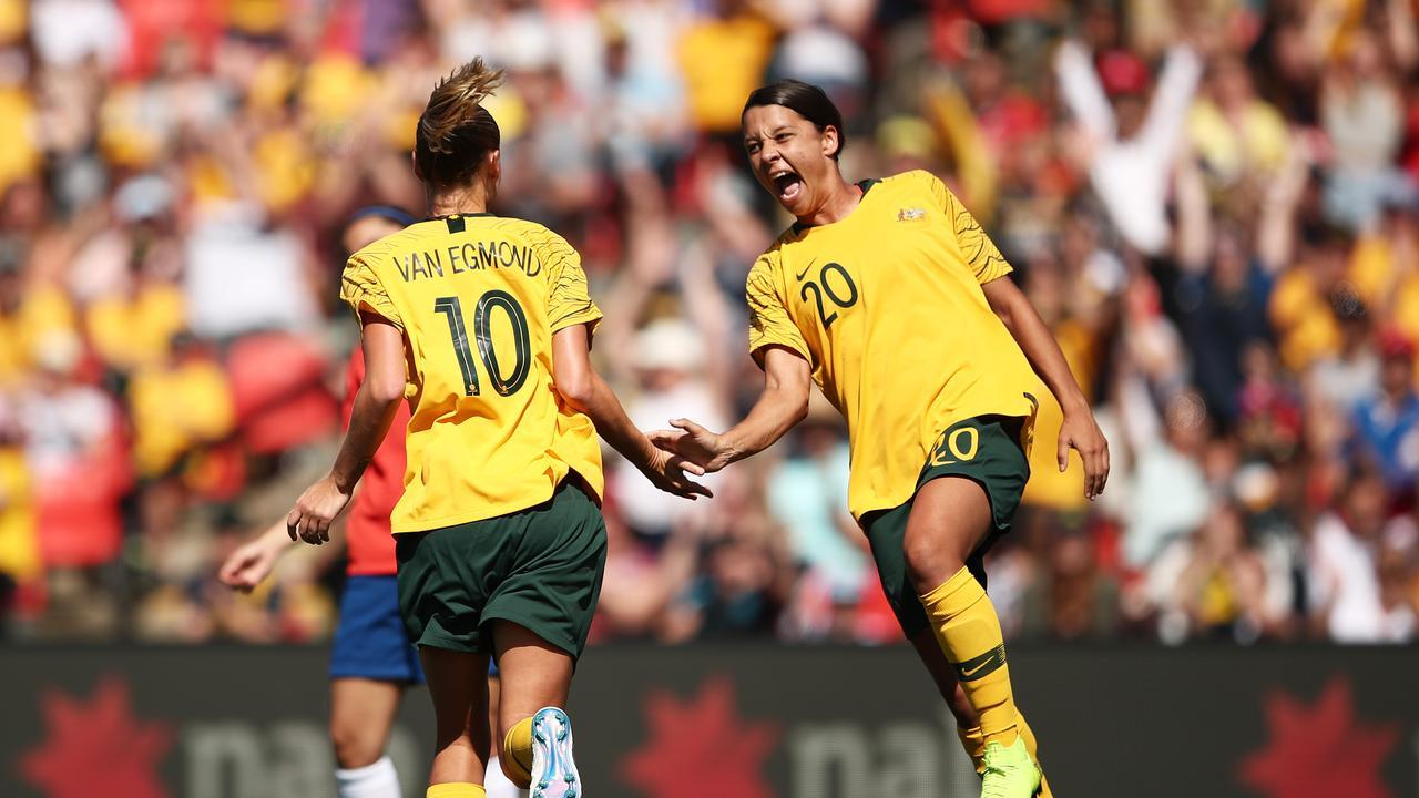 Emily van Egmond (L) of Australia celebrates with Samantha Kerr (R)
