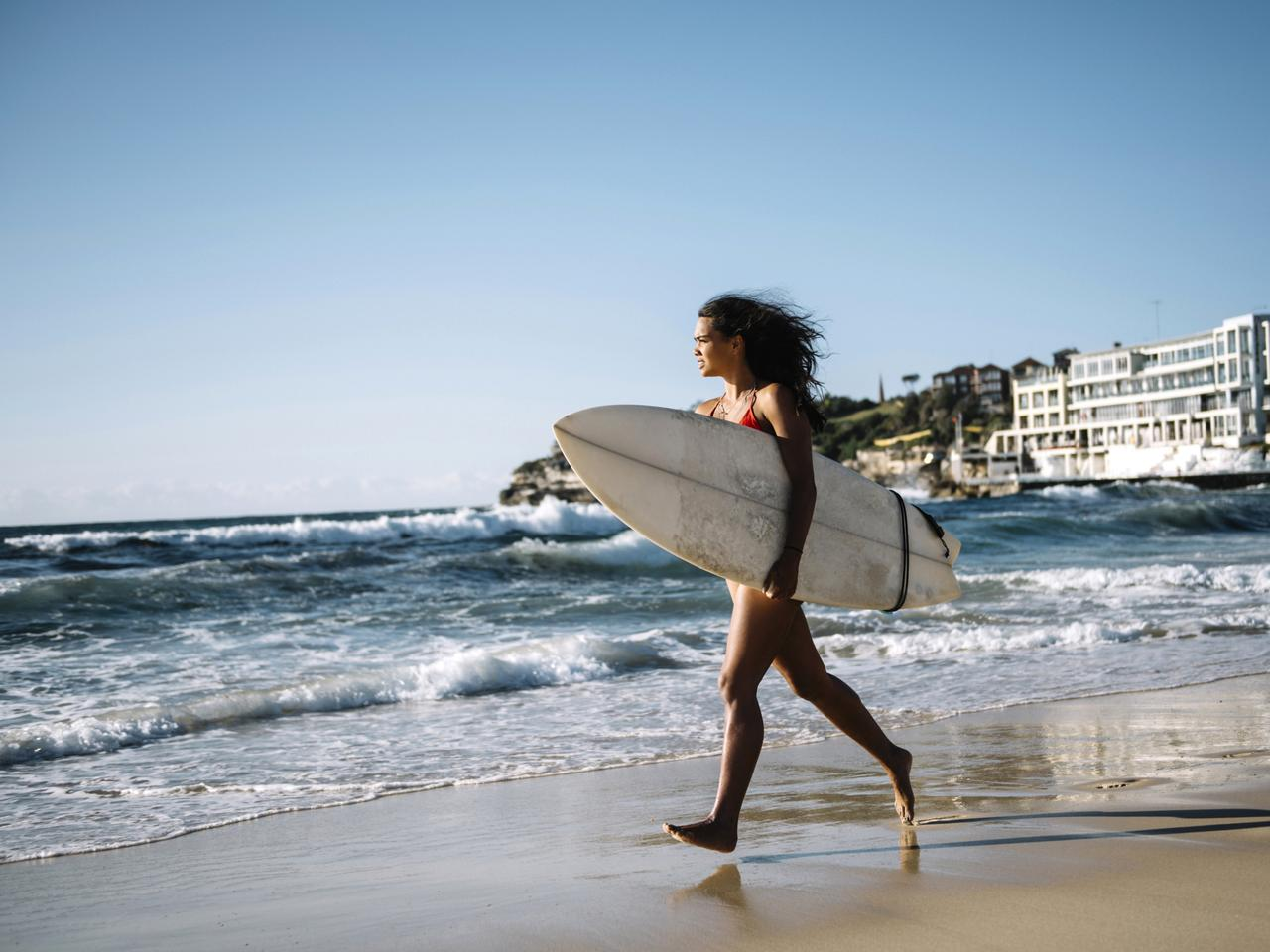 Young woman going for a surf